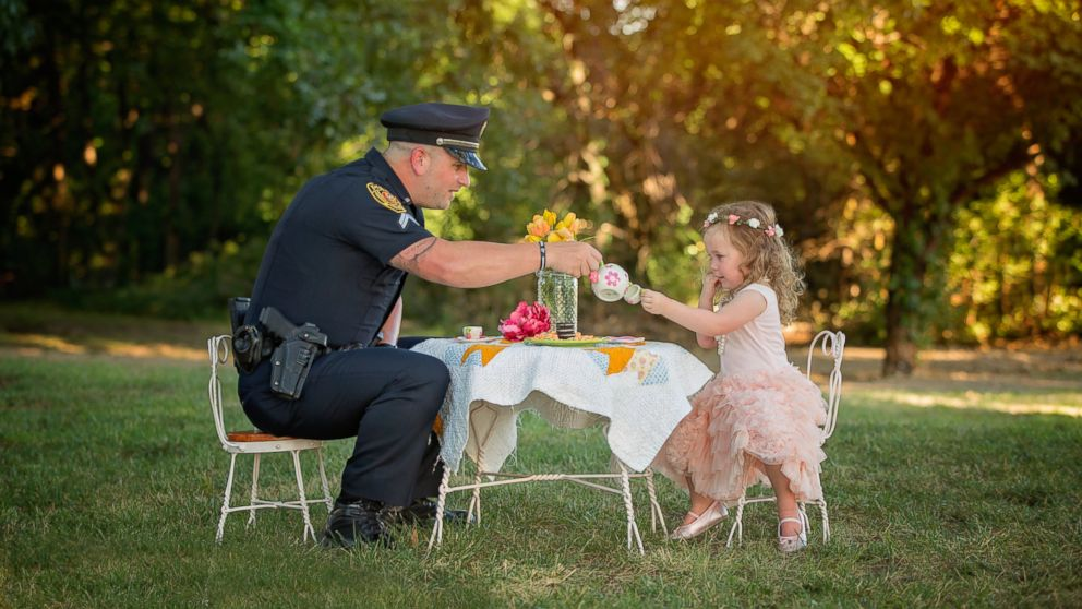 PHOTO: On July 26, 2015, Bexley, 2, the daughter of Tammy Norvell of Rowlett, Texas, was saved by Officer Patrick Ray after being choked on a penny. One year later, the pair had a tea party photo shoot.