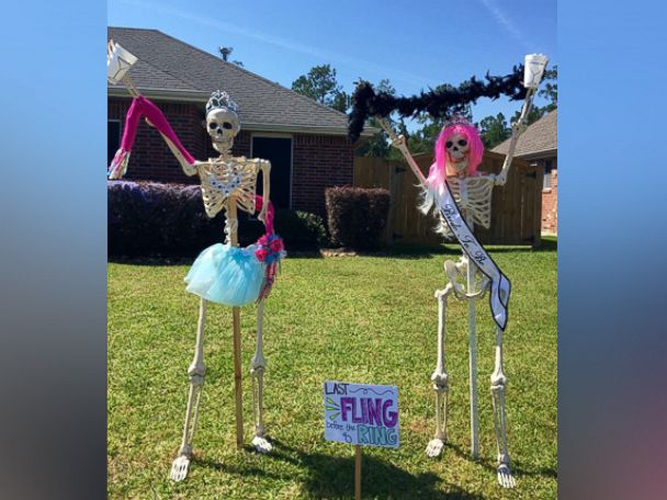 photo amy b moses of lumberton texas poses her skeleton decorations into various