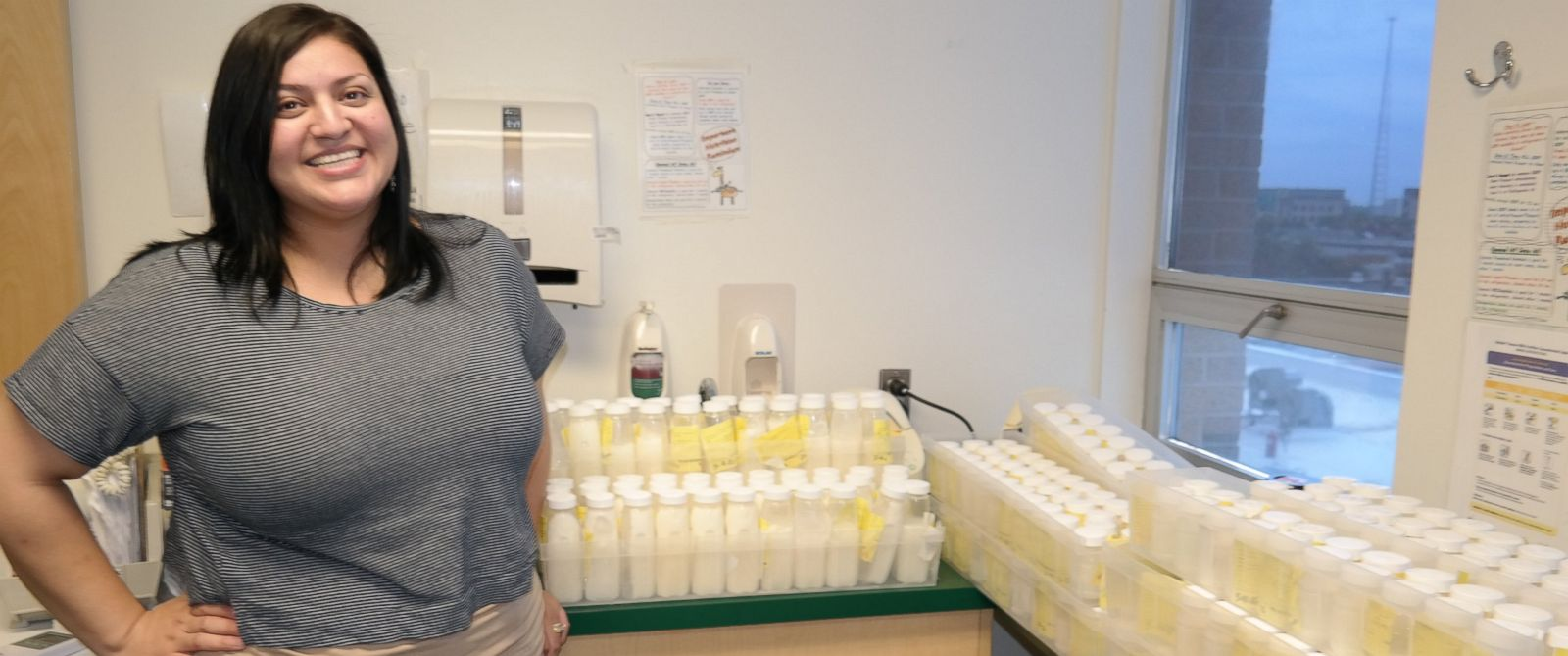 PHOTO: Mikah Duncan poses with the 15 gallons of breast milk she donated.