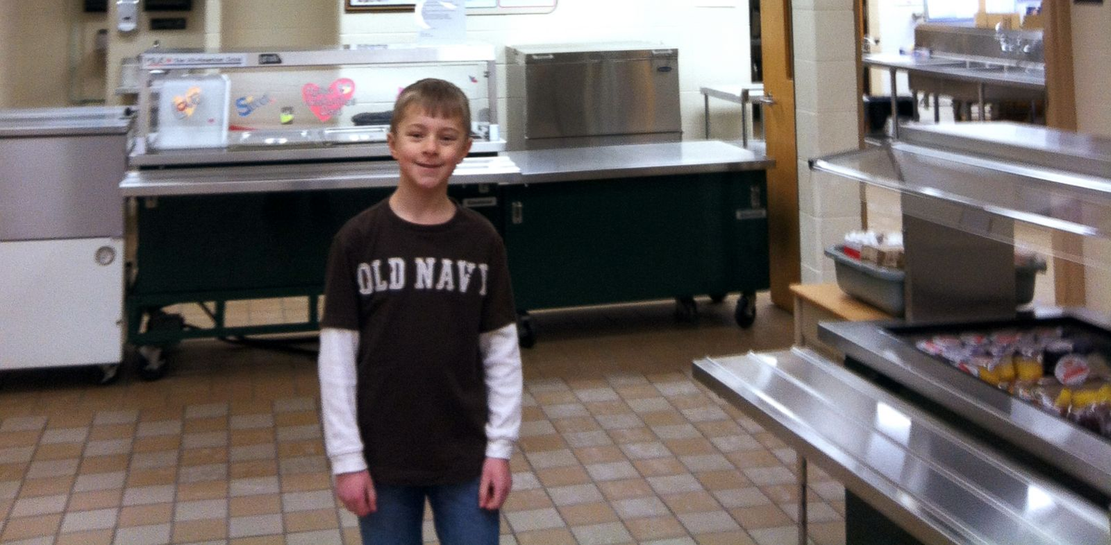 PHOTO: Cayden visits Voyager Elementary in Howell, Mi. to make his second donation.
