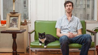 PHOTO: Grant with his cat Tux
