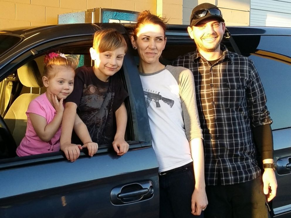 PHOTO: Hunter Cmelo and his family pose with their new minivan and local radio host Bill Meyer.
