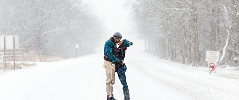 PHOTO: Felicia Sam and David Nartey braved the snow in Fort Meade, Maryland to capture the perfect shot for their engagement photos.