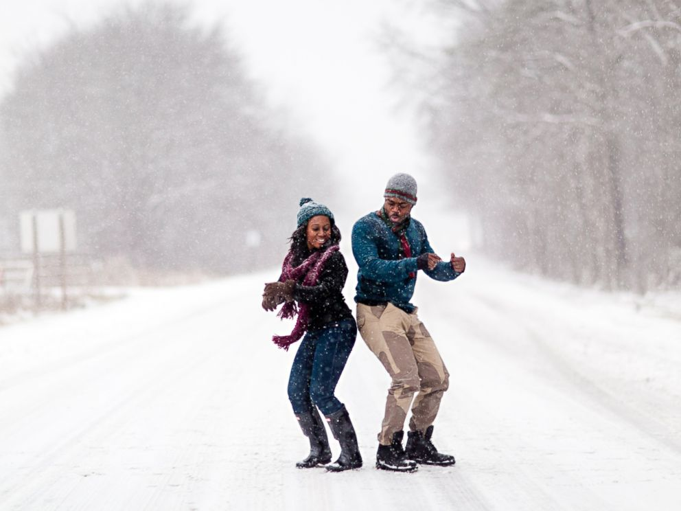 PHOTO: Felicia Sam and David Nartey braved the snow in Fort Meade, Maryland for wintery engagement photos.