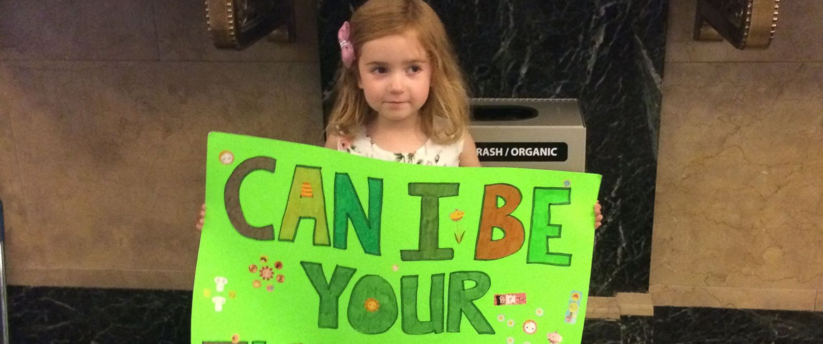 PHOTO: The four-year-old held a sign advertising her services at City Hall on Friday.