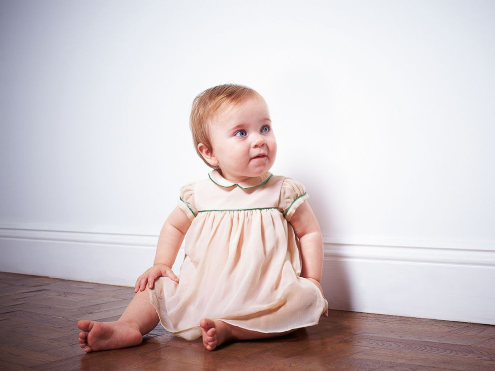 PHOTO: The piped baby dress at Marie-Chantal Children is a natural choice for flower girls or baby guests at summer weddings.