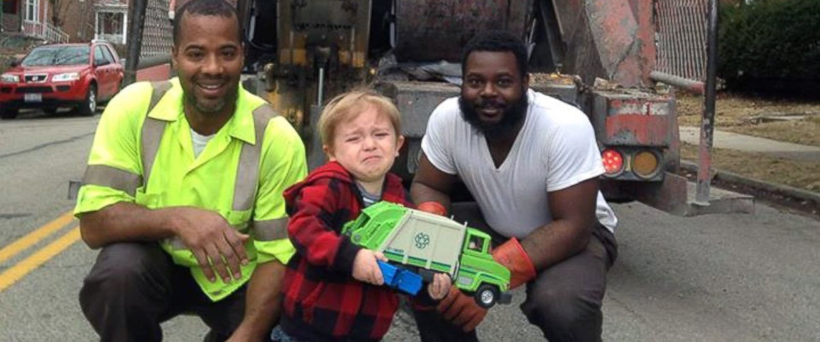 "PHOTO: Ollie Kroner posted this photo to Facebook, March 13, 2015, with the caption, ""Quincys been waiting all week to show the garbage men his garbage truck. But, in the moment, he was overwhelmed in the presence of his heroes."""