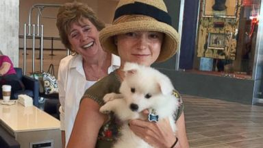 PHOTO: Lacey Dietz seen with her new dog, Casper, on August 13 at Tampa International Airport, along with her grandmother, Billy Meehan.