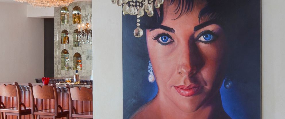 PHOTO: A portrait of Elizabeth Taylor hands in the Casa Kimberly, which she previously owned.
