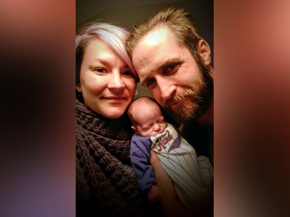 PHOTO: Micheal Burritt and Jessica Collinson pose with their newborn son, Hugo.