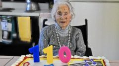 PHOTO: Sally Mitchell admires her cake as she celebrates her 110th birthday on Nov. 25, 2014.