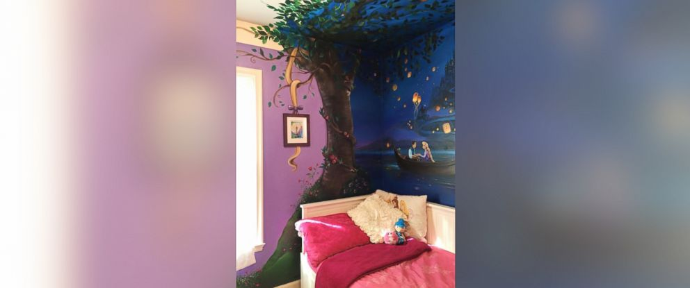 "PHOTO: Jennifer Treece, of Michigan, painted a mural inspired by the Disney film ""Tangled"" on her 8-year-old daughters wall."