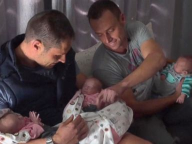 PHOTO: Christo Menelaou, 37, and Theo Menelaou, 38, of Pretoria, South Africa, welcomed triplets via surrogacy on July 2.