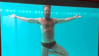 PHOTO: Fitness expert Scott Cole performs underwater yoga poses, 2014.
