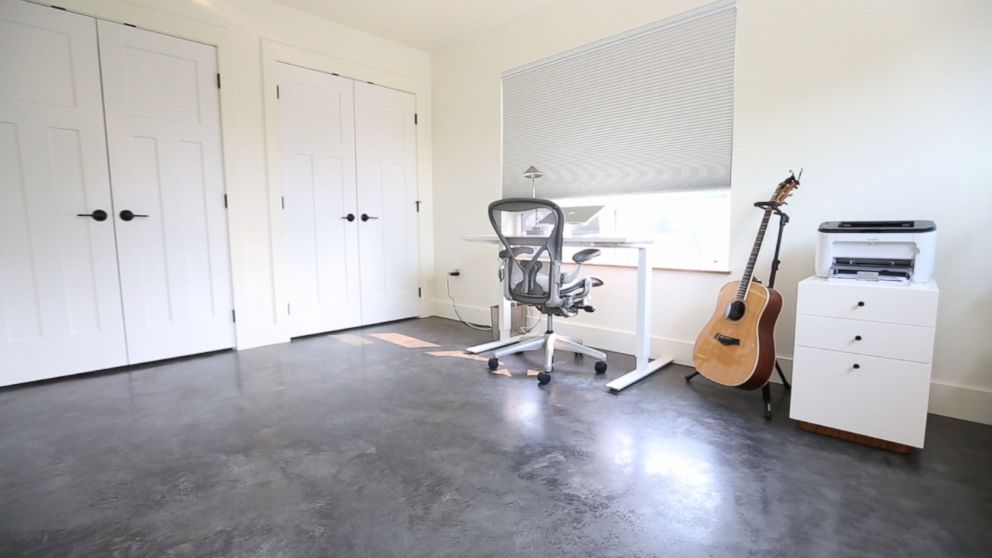 PHOTO: Joshua Fields Millburns desk and guitar are pictured here in a room at his minimalist Missoula, Mont., home.
