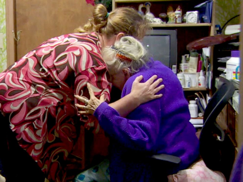 PHOTO: Edythe De La Rosa, a 91-year-old woman from Stayton, Oregon, said she believes her van, which had her wheelchair and walker in it, was stolen sometime between Oct. 15, 2016 and Oct. 16, 2016. Her care keeper holds her as she cries.