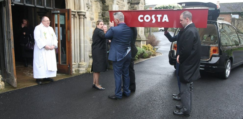 PHOTO: In this undated file photo, the funeral of Karen Lloyd is pictured in Old Town, Wiltshire, England. Lloyd was buried in a Costa coffee coffin, because of her love for lattes.