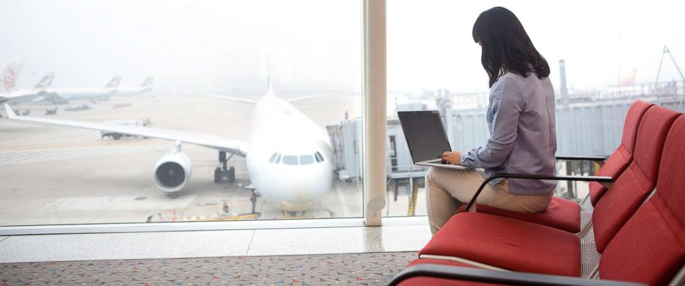 PHOTO: Woman at airport using laptop in an undated stock photo.