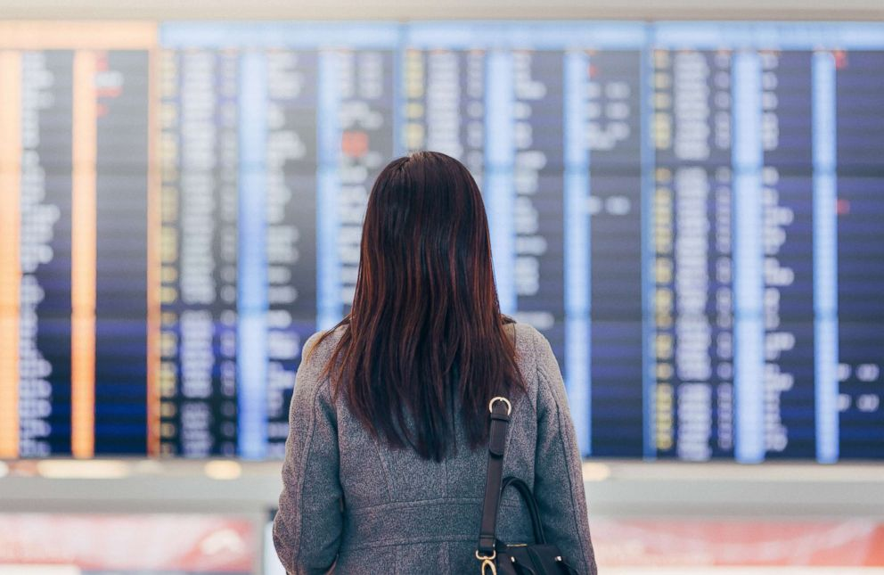 PHOTO: A woman checks arrivals and departures at the airport terminal in this undated stock photo.