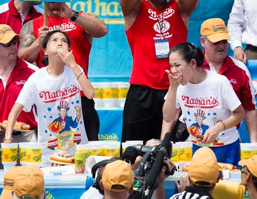 Competitors Chow Down Nathan's Hot Dogs