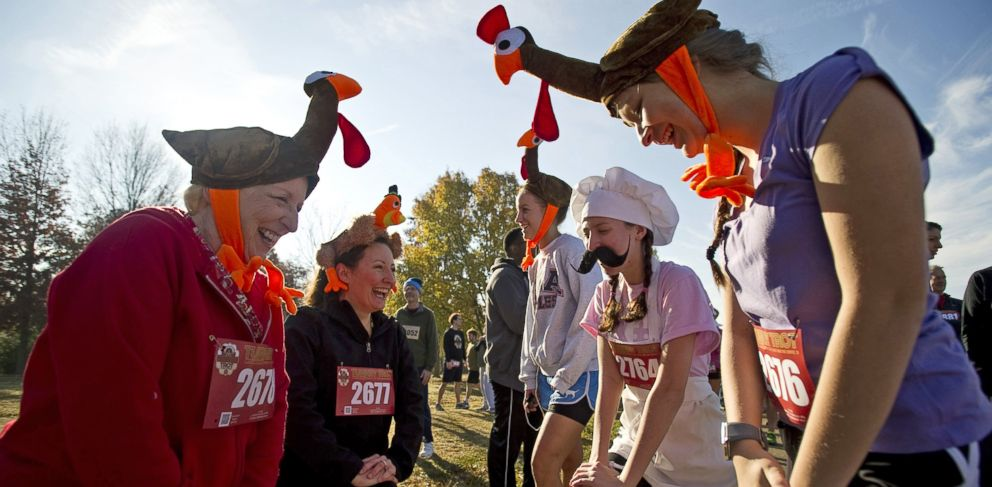 PHOTO: Dressed as turkeys and a chef, three generations of runners from the same family stretch before participating in the annual Memphis Turkey Trot race in Memphis, Tenn., Nov. 22, 2012.