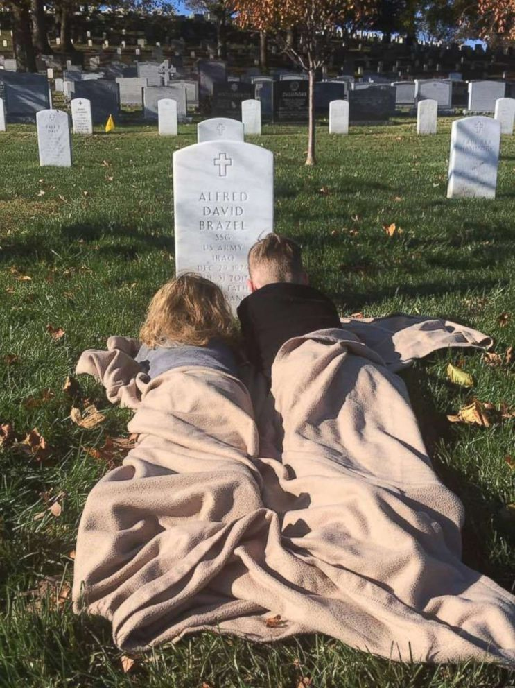 PHOTO: Mason and Mylan Brazel visited their fathers grave to see his headstone for the first time last month at Arlington National Cemetery.