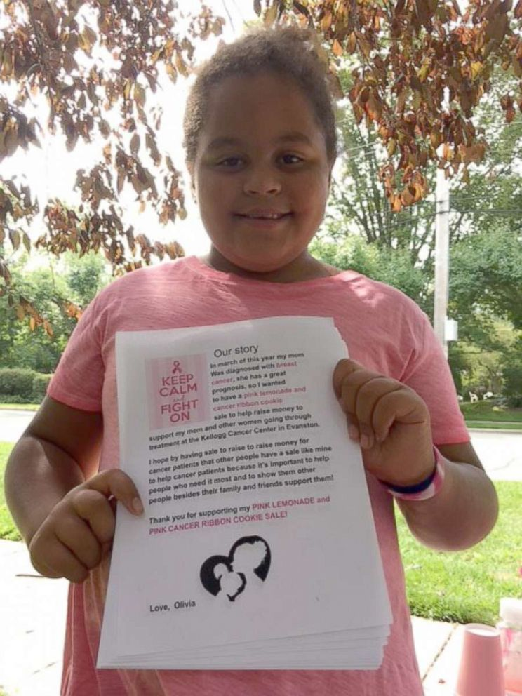 PHOTO: Olivia Ohlson, 10, holds a flier she made for a bake sale in her Evanston, Illinois, neighborhood to raise money for people affected by breast cancer.