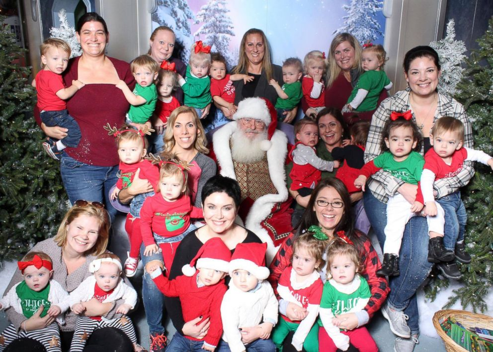 "PHOTO: A mommy group called the ""Chicago Twin Moms"" took a group holiday photo with Santa Claus in Woodfield Mall in Schaumburg, Ill., Nov. 27, 2017."