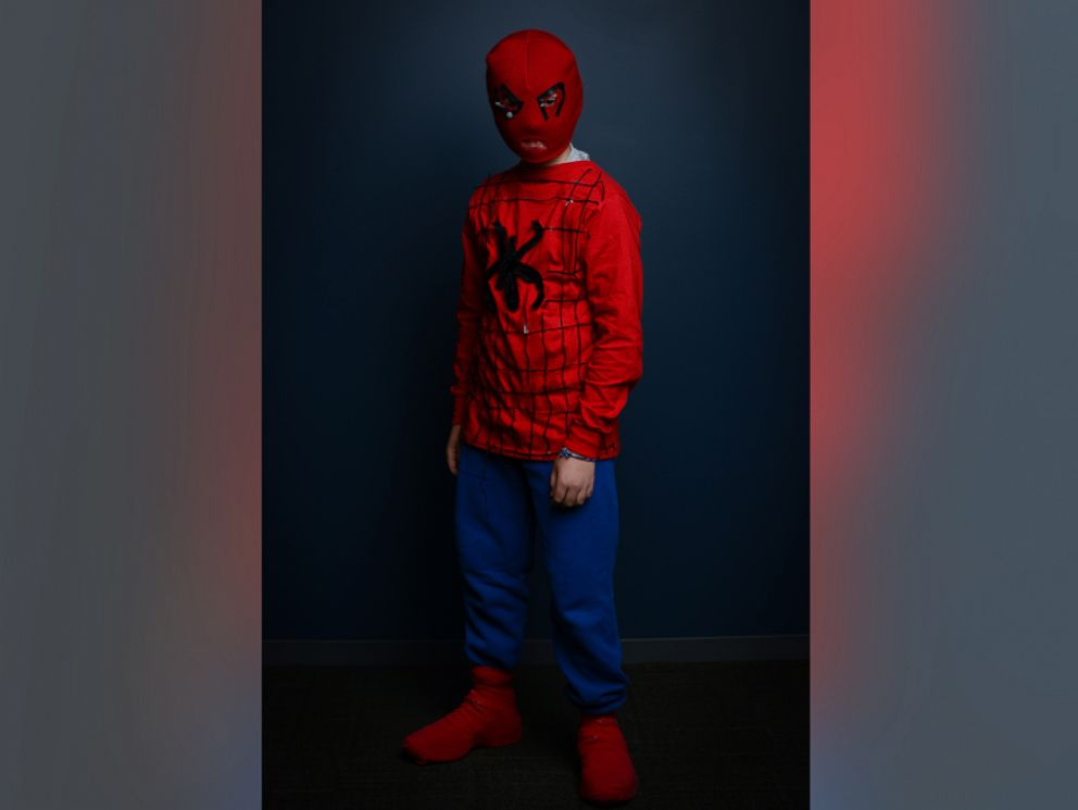 PHOTO: To create this Spider-Man look, use an adult-sized red snow hat and cut out holes for the eyes and the nose.