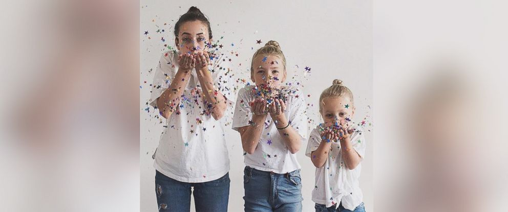 PHOTO: Dominique Davis and her daughters Penny, 4, and Amelia, 11, pose in identical outfits.