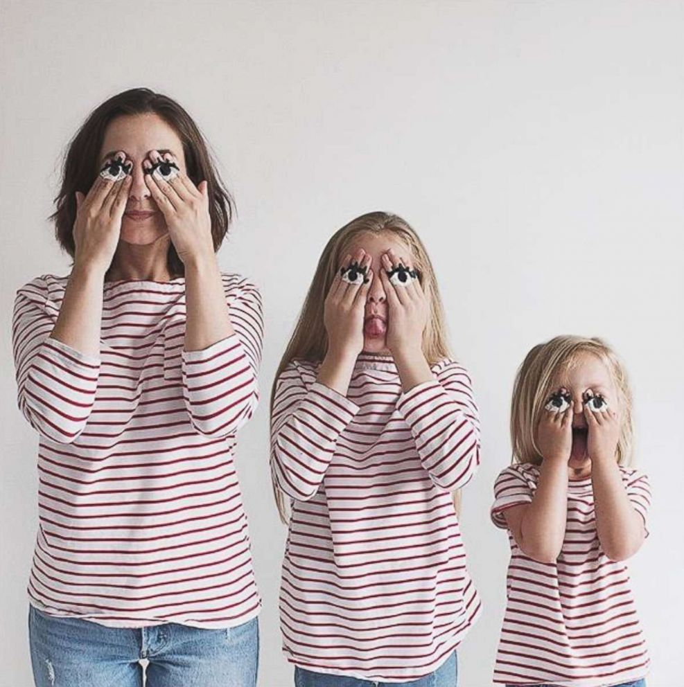 PHOTO: Dominique Davis does a silly face with her daughters Penny, 4, and Amelia, 11.