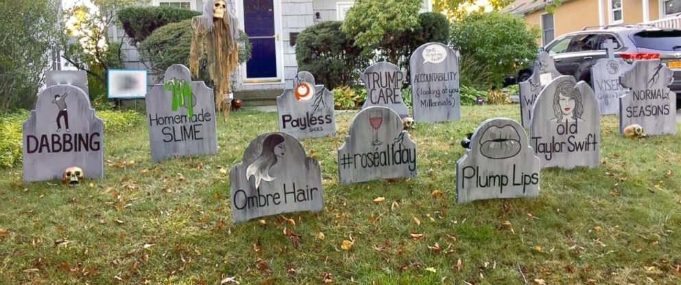 PHOTO: The art teachers gravestones pay homage to normal seasons and watching live tv.