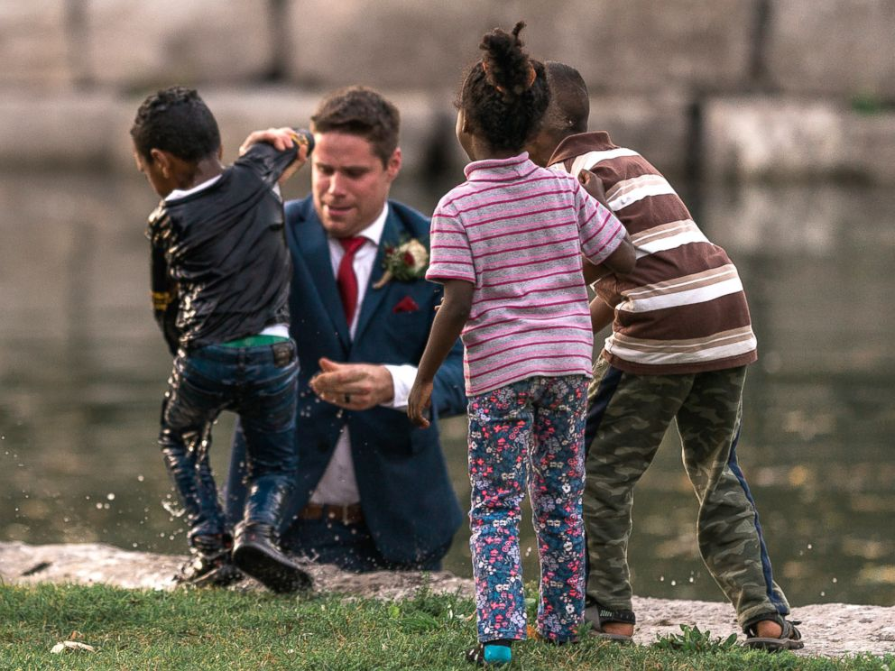 Watch as hero groom saves boy in pond during wedding shoot