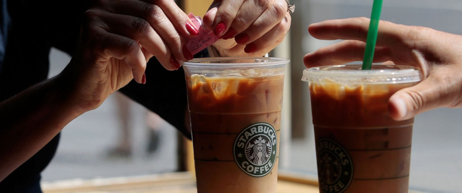 PHOTO: A couple has iced coffee drinks at a Starbucks Coffee shop in lower Manhattan, New York.