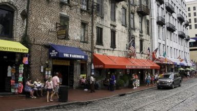 PHOTO: Tourists walk along River Street in Savannah, Ga. on Aug. 23, 2013.