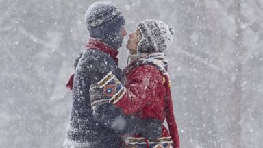 PHOTO: A couple kisses in the snow.