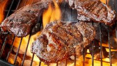 PHOTO: Steaks are cooked on an outdoor grill in an undated stock photo.