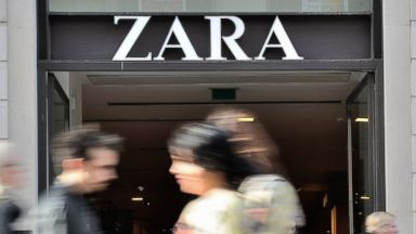 PHOTO: People walk in front of the entrance of a Zara clothing store on Feb. 24, 2014 in the French northern city of Lille.
