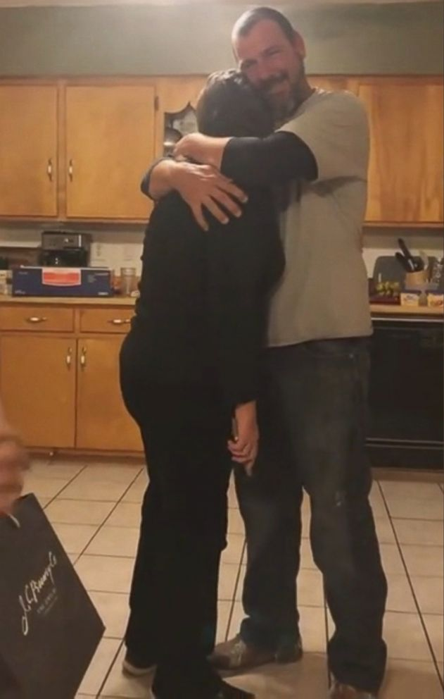 PHOTO: Cynthia Dozier hugs her son, Welsey Dozier, after learning he and his wife are expecting.
