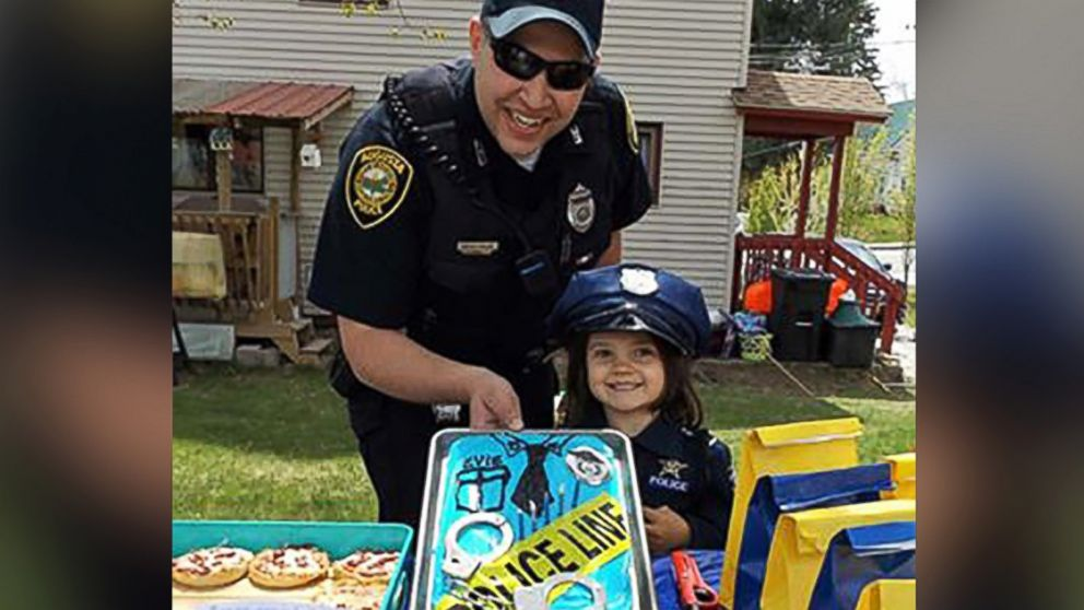 PHOTO: Evie Flanagan, 5, of Augusta, Maine, was so happy when Officer Brad Chase surprised her at her birthday party.
