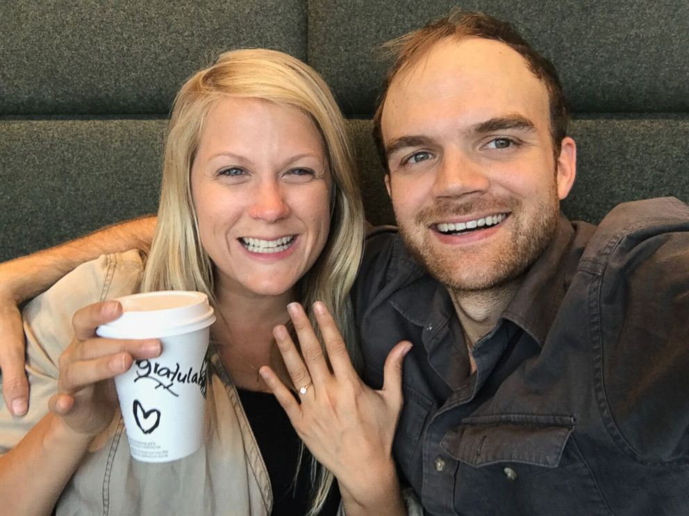 PHOTO: Esther Havens and Austin Mann smile after becoming engaged in a Starbucks at the Amsterdam Airport Schiphol years after Mann left her a note hidden in the store.