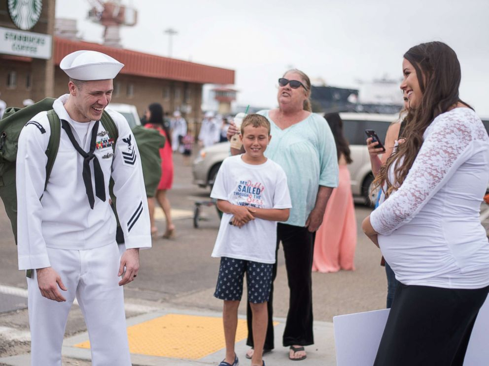 PHOTO: Natasha Daugherty surprised her husband Chris with her pregnancy when he arrived home from deployment on June 23, 2017.