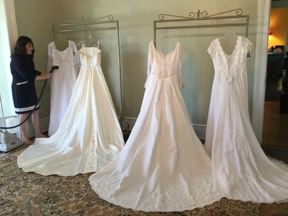 PHOTO: Bridal store owner Allison Drake, of Madison, N.C., stands next to wedding gowns donated to her store by Margarette Powell.