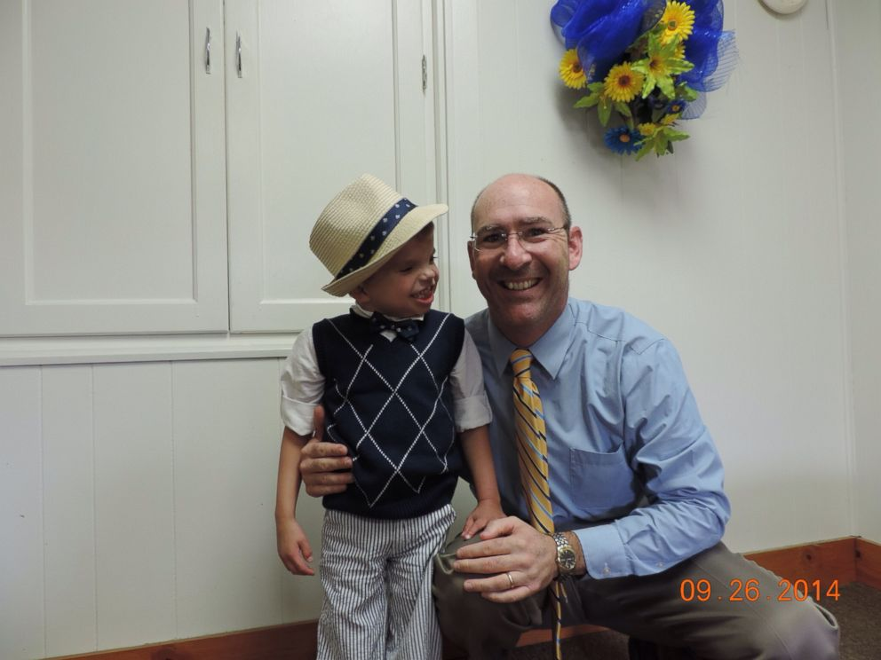 PHOTO: Planitz, 6, and Dustin Day, formerly the principal at Tri-City High School.