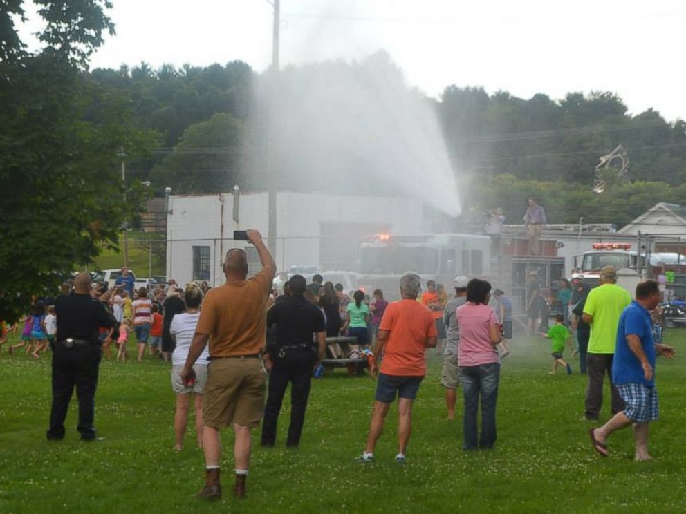 PHOTO: The local fire department sprayed the kids with the hose prior to a water balloon fight.