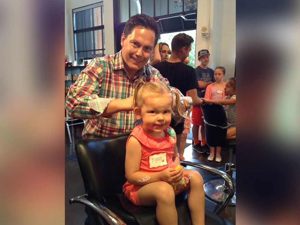 PHOTO: Envogue Salon in Denver is the site of a beer and braids class for dads to learn about styling little girls hair.