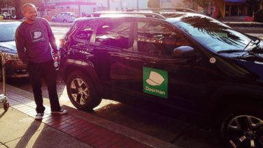 PHOTO: A Doorman delivery agent standing in front of a company vehicle.