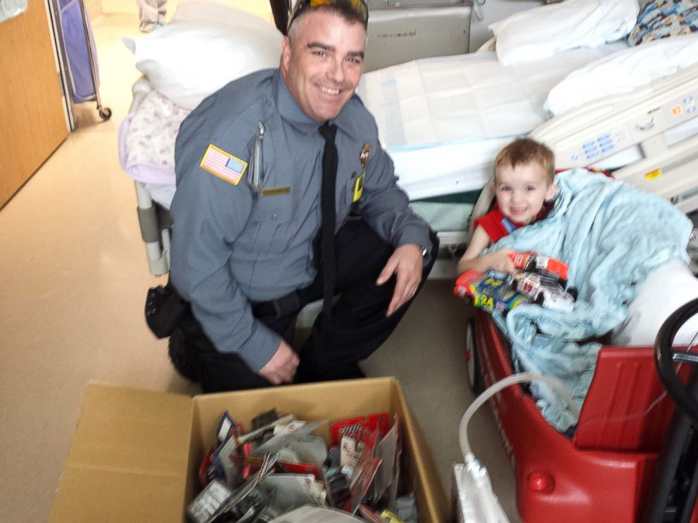 PHOTO: Ethan receives a car collection from a Utah security officer.