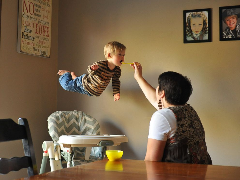 PHOTO: Wil takes flight while his mom feeds him.