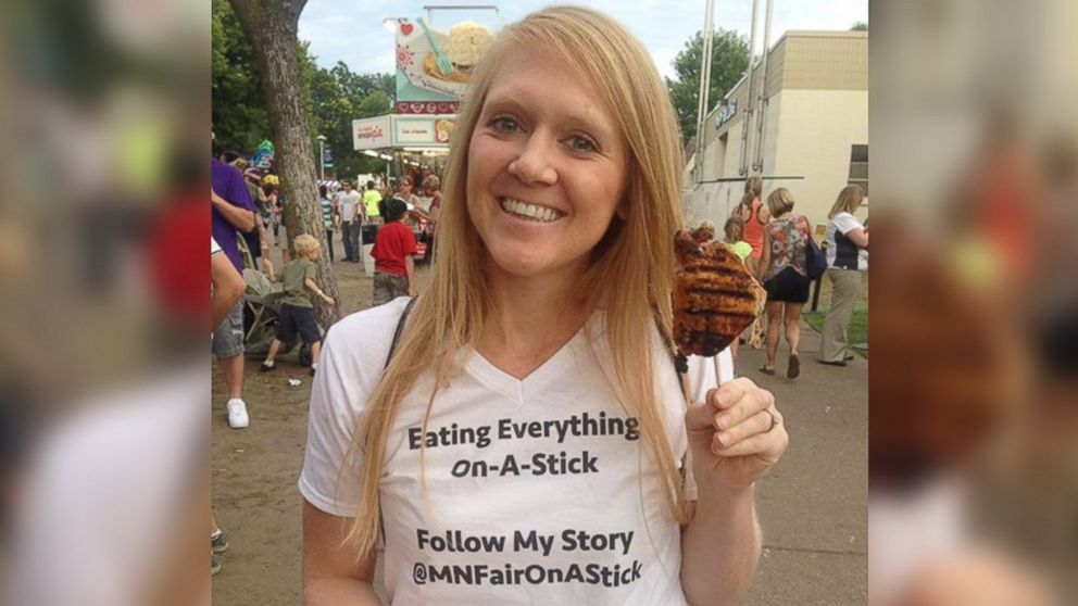 PHOTO: Mandy Colten eating chicken on a stick for charity.